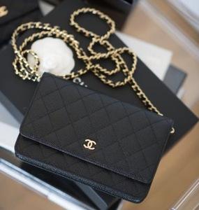 Rent: Chanel WOC in black caviar